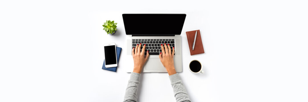 Overhead shot of woman working on laptop