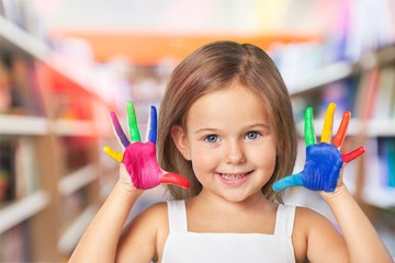 Little cute girl  with hands in colored paint
