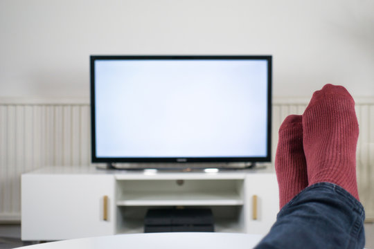 Feet up in front of TV with a blank screen