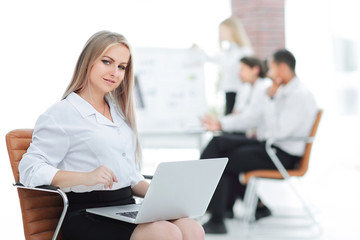 Executive business woman with a laptop on blurred background