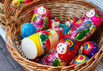 Russian wooden souvenir dolls matryoshka in a wicker basket.