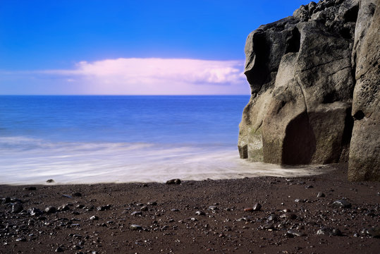 Rock formation on Praia Formosa beach on Portuguese island of Madeira