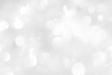 A brilliant white background with circles and ovals. Template for a holiday card with bright and sparkling lights.