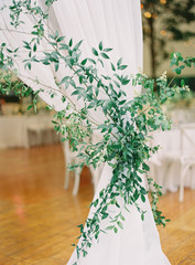 Leaves and branches being used as a curtain during a wedding reception