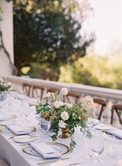 Place settings at an outdoor wedding reception
