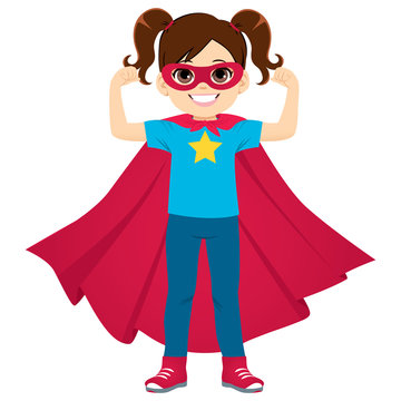 Cute super hero little girl standing flexing arms showing strength