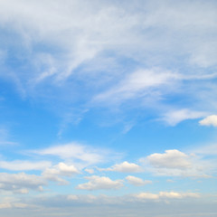 Light cirrus and cumulus clouds against the blue sky.