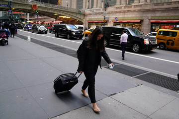 A woman pulls her luggage outside Grand Central Terminal in New York