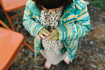 Young girl with green paint on her hands