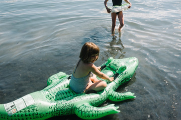 Young girl sitting in an inflatable swim toy,