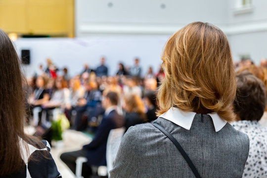 woman in the meeting back view