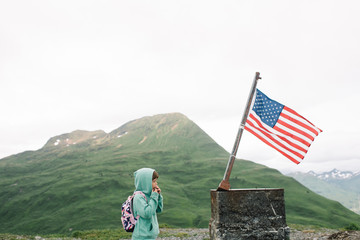 Young girl looking at an American Flag
