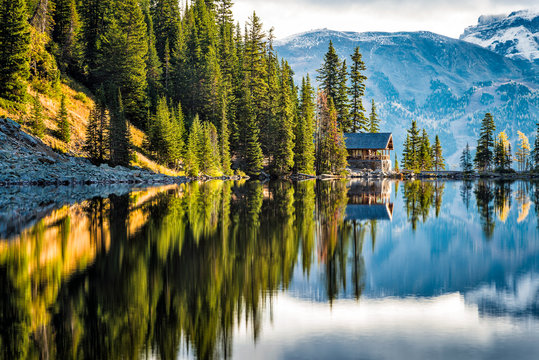 lake in the mountains with cabin