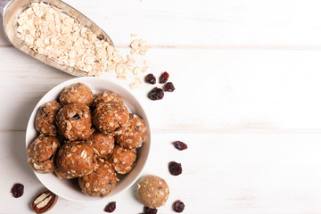 Healthy organic energy granola bolls with nuts, cacao, oats and raisins - vegetarian sweet bites without sugar