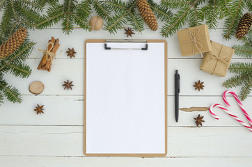 New year mock-up Blank clipboard and Christmas decoration on white wooden background. Flat lay, top view. To do