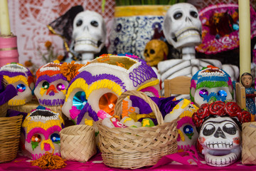 A typical scene of an altar during the day of the dead celebratio in mexico, skull candy, handmade baskets, colorful