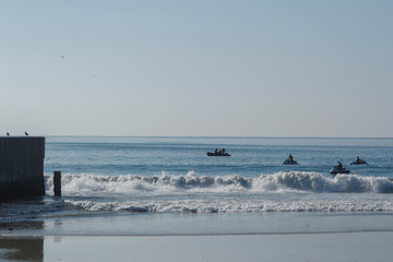 U.S. Border agents patrol the Pacific Ocean where the U.S. Mexico border wall enters the water at Border Field State Park in San Diego