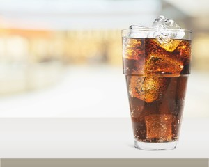 Fototapeta Glass of cola with ice cubes isolated on white background
