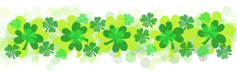 Shamrock four leaf clover, St Patrick's Day, March green and white banner header background in wide horizontal format