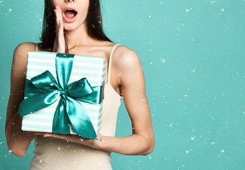 picture of Surprise astonished woman with gift box