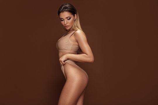 Sexy caucasian woman posing in swimwear.
