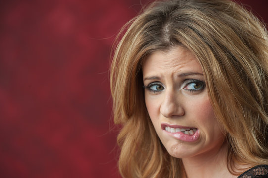 Young woman visibly uncomfortable facial expression