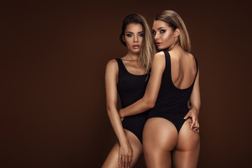 Two sexy attractive twins women posing