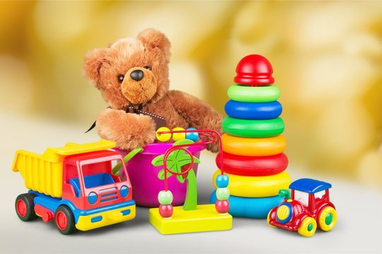 Composition of various toys on blurred background