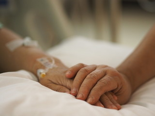 Hand to encourage Patients sleep to saline at the hospital ward get well soon