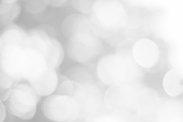 Abstract glamorous white and silver bokeh lights glitter sparkle. Defocused background have luxury golden color party invite for birthday, anniversary, holliday, new year xmas or snow christmas blur.