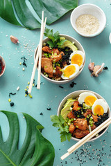 Top view poke bowls fried rice chicken fillet eggs top view Asian food