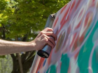 Background concept creativity tree green leaves painter hand aerosol closeup