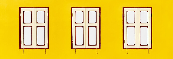 Wall Mural - Vintage three wooden windows classic on the yellow concrete wall. Color white wooden window. with blank copy space.