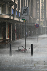 Forgotten bicycle under the rain in the street of Rotterdam.