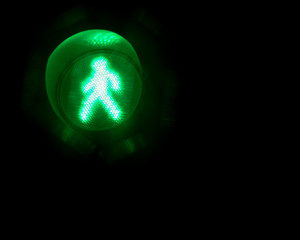 Pedestrian control light, isolated green man sign, walk signal
