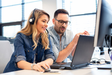 Two call center agents working together.