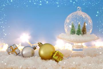 Christmas image of christmas trees inside glass ball over wooden table.