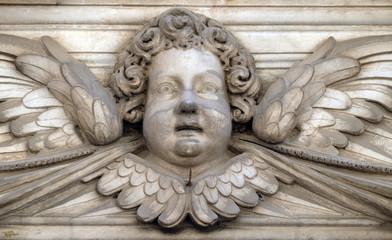 Angel on the portal of Santa Maria Corteorlandini church in Lucca, Tuscany, Italy