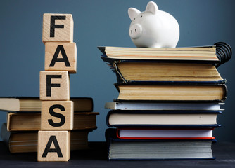 FAFSA Free application for federal student aid. Letters on the cubes.