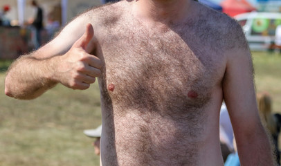 A man with a hairy chest and stomach as background