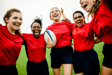 Cheerful rugby players celebrating their victory