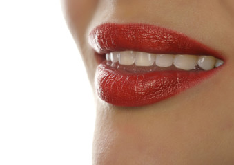 Extreme close up of sexy lip. Woman pursing her lips in a sexy seductive gesture. open smile