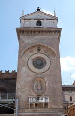 Clock tower of Palace of Reason (Palazzo della Ragione with the Torre dell'Orologio) in Mantua, Italy