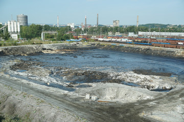 The former dump toxic waste in Ostrava, oil lagoon. Effects nature from contaminated water and soil with chemicals and oil, environmental disaster, contamination of the environment
