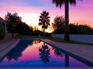 Swimming Pool outdoors in the garden with beautiful sunset