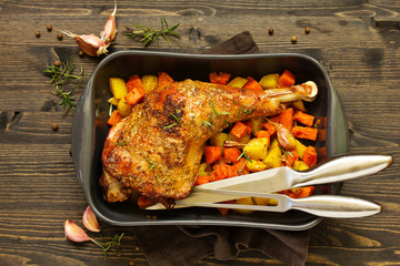baked turkey thigh with vegetables.