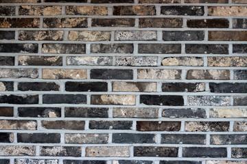Multicolored brick wall closeup, texture background