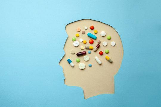 The profile of man and in his head lot of pills. Headache treatment