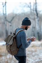 Professional nature photographer outdoor in the winter forest.