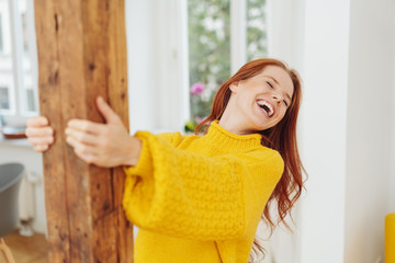 Laughing carefree young woman